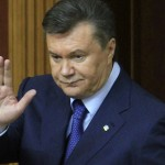 Ukraine's President Viktor Yanukovich acknowledges deputies after delivering his annual address in the chamber of the Ukrainian parliament in Kiev